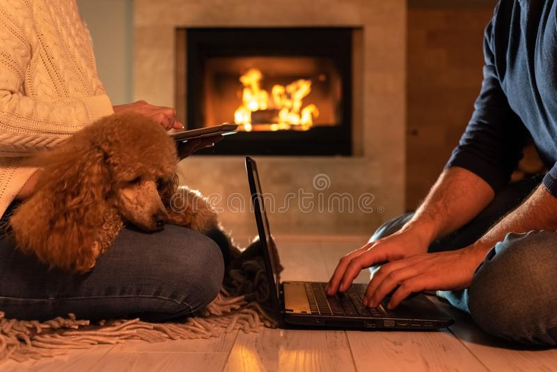 Couple of freelancers siting at the floor with a laptop and tablet. royalty free stock images