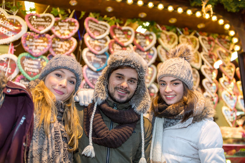 Couple and Friend drink Mulled Wine on the Christmas Market royalty free stock photography