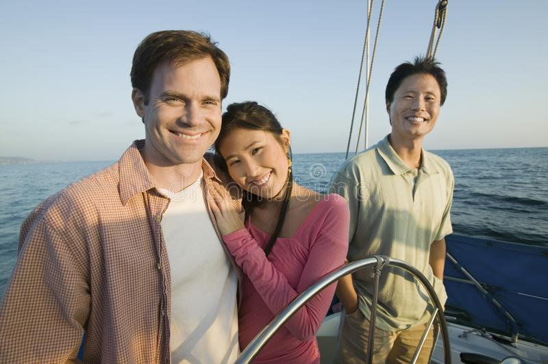 Download Couple With Friend On Yacht Stock Photo - Image: 13584872