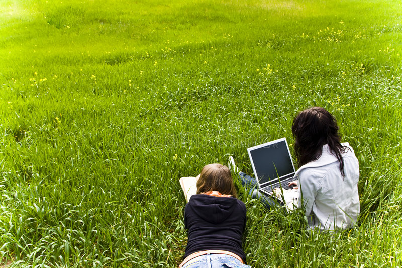 Download Couple Of Friends Enjoying At The Meadow Stock Images - Image: 4732614