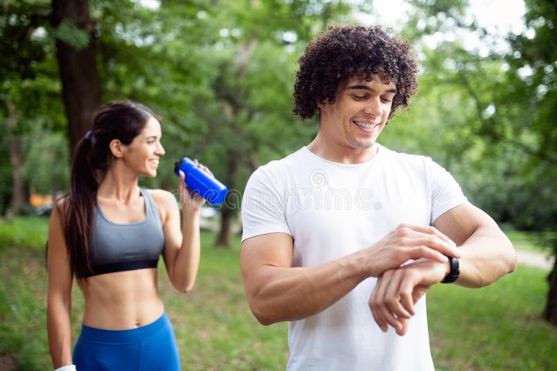 Couple jogging and running outdoors in nature. Couple friends jogging and running outdoors in nature royalty free stock photos