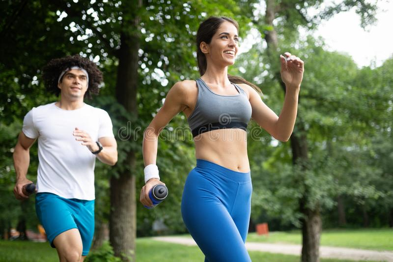 Couple jogging and running outdoors in nature. Couple friends jogging and running outdoors in nature stock photo