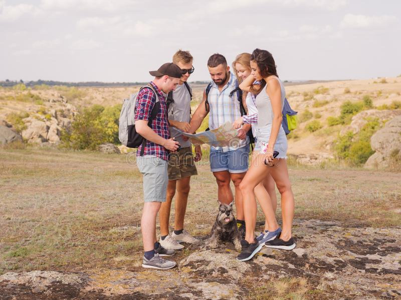Young tourists are pondering the future road of their journey stock photography