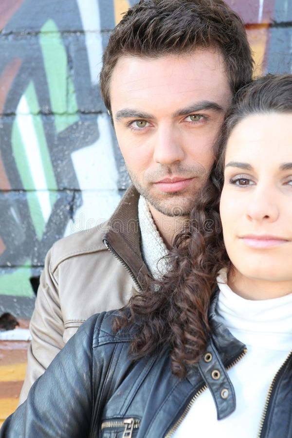 Download Couple In Front Of Graffiti Wall Stock Image - Image: 22406033