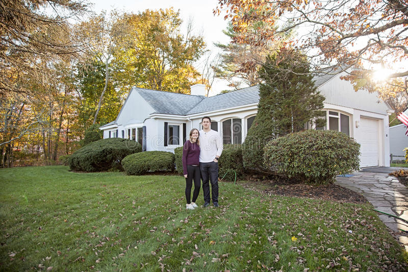 Couple in front of house stock images