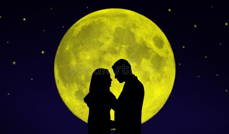 Couple in front of the Moon. Silhouette of a couple standing in front of giant Moon surrounded by stars stock images