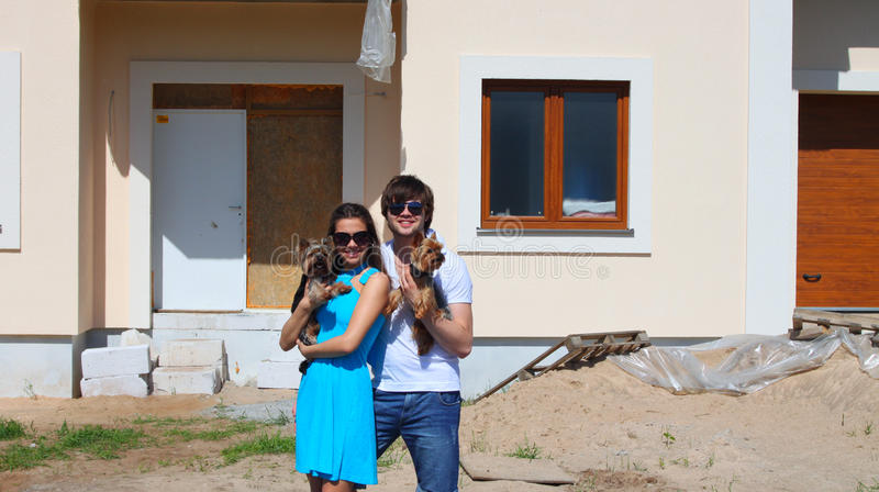 Couple in front of their new house