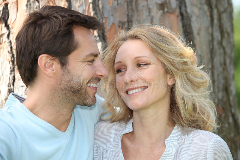 Couple in front of a tree stock photos