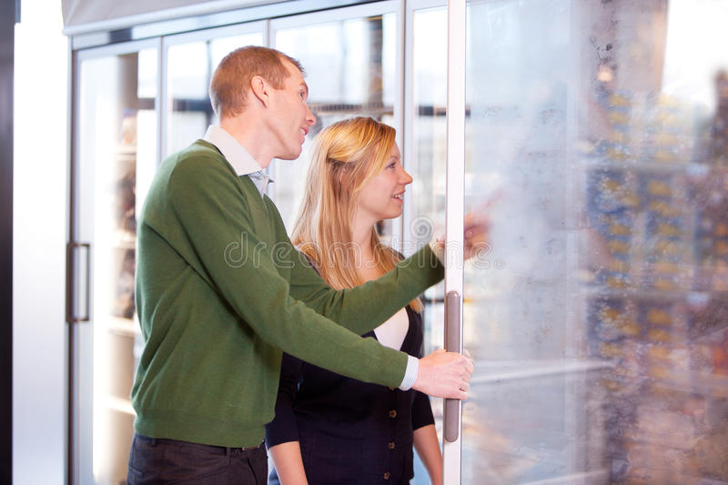 Couple in Frozen Food Section stock photos