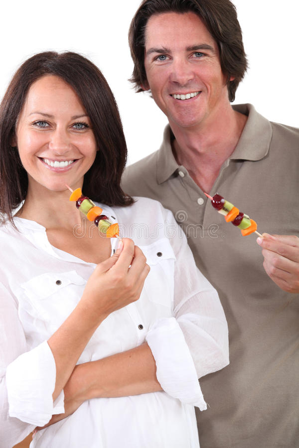 Couple With Fruit Skewers Stock Image