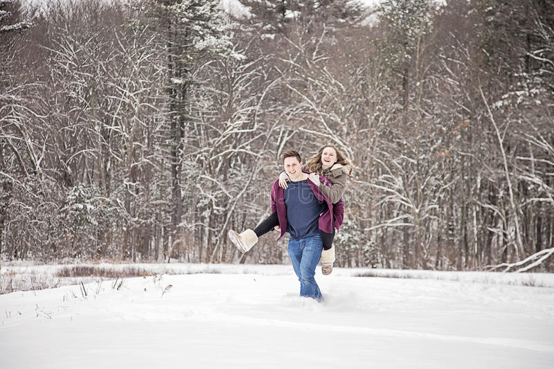 Couple fun in snow stock photos