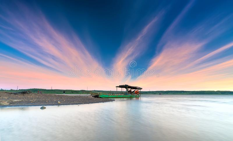 Couple fun welcome sunset on the riverside with impressive clouds in sky,. Nai, Vietnam - February 19th, 2018: Couple fun welcome sunset on the riverside with stock images