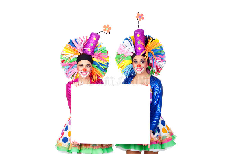 Couple of funny clowns with a blank poster. Isolated on white background royalty free stock image
