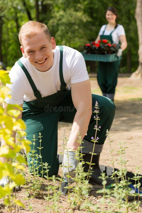 Couple of gardeners in the garden stock photo