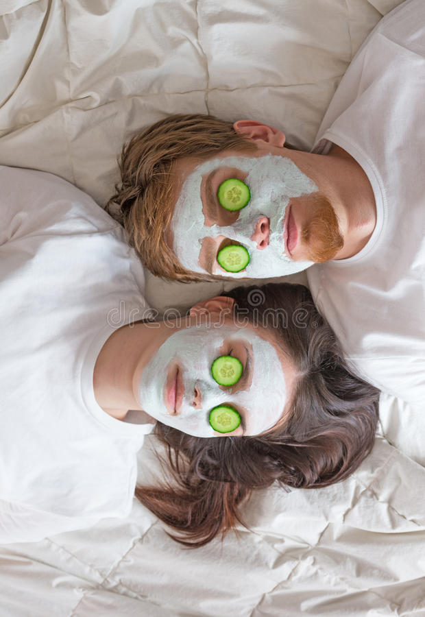 Couple getting homemade facial mask royalty free stock photo