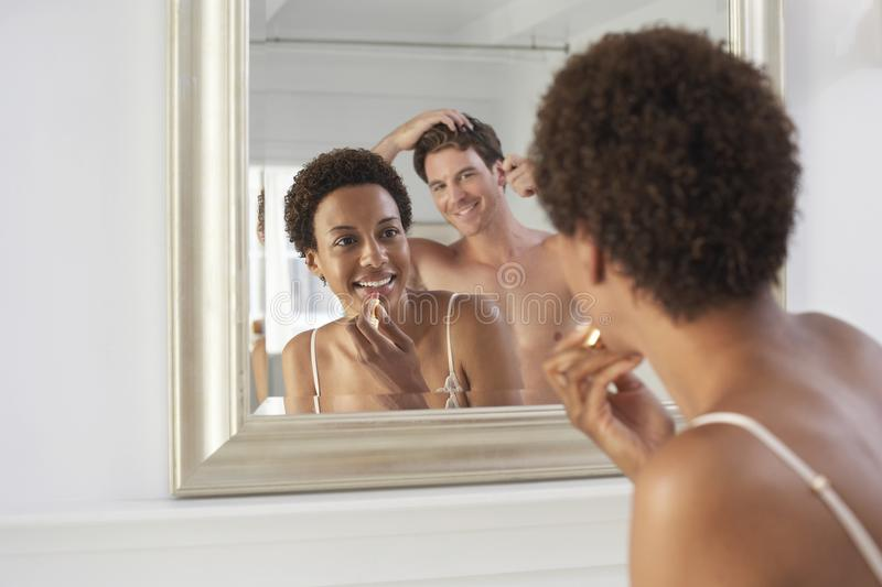 Couple Getting Ready In Bathroom stock photography