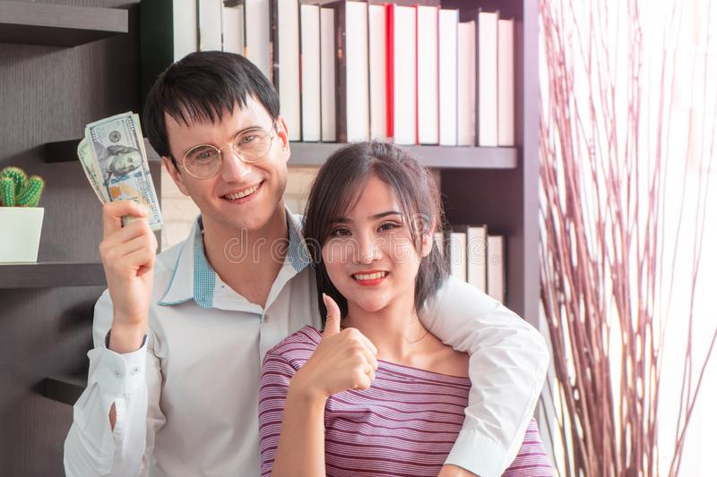 Couple getting rich in family business royalty free stock image