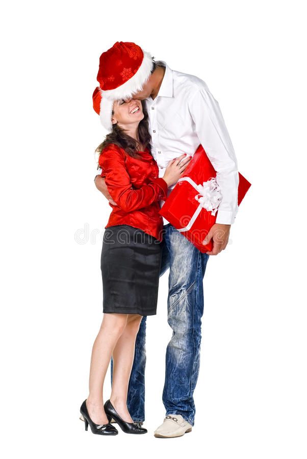 Couple with a gift. Beautiful young couple with a gift stock photos
