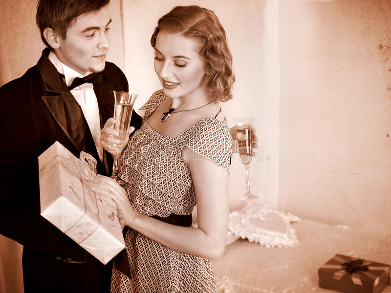 Couple with gift box. Black and white retro. royalty free stock photo