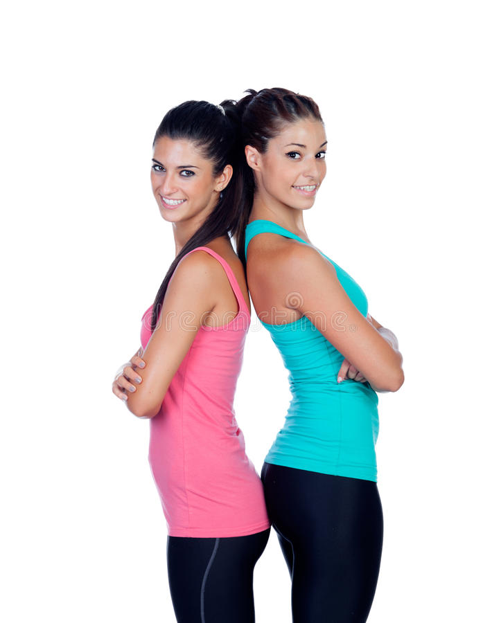 Couple of girlfriends with fitness clothes. Isolated on a white background stock photography