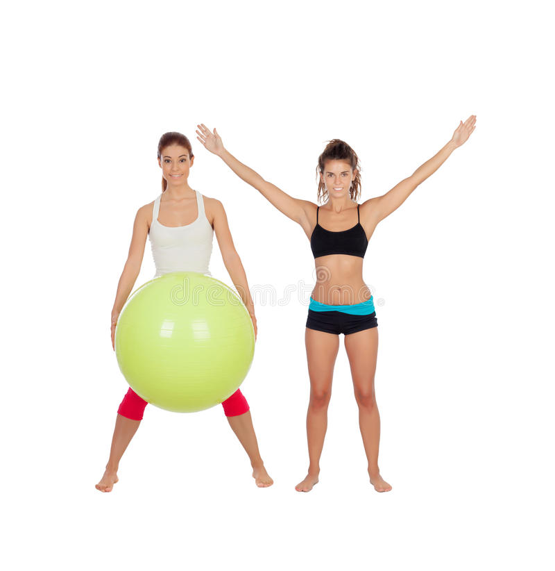 Couple of girlfriends with fitness clothes. Isolated on a white background royalty free stock photos