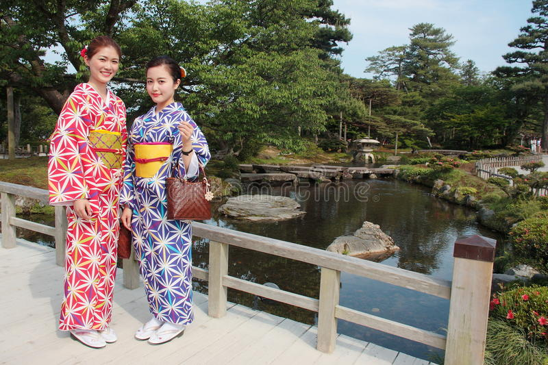 Couple of girls wearing colorful traditional japanese kimono in Kenrokuen, the famous Japanese landscape garden in Kanazawa Japan stock images