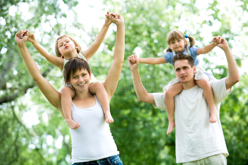 Download Couple Giving Children Piggyback Rides Royalty Free Stock Photo - Image: 10448955