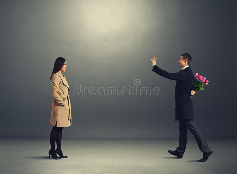 Couple going to meet each other. Happy couple going to meet each other in the dark room royalty free stock photography