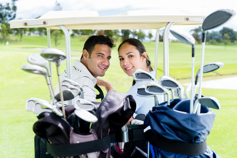 Download Couple in a golf cart stock photo. Image of players, cheerful - 33871288