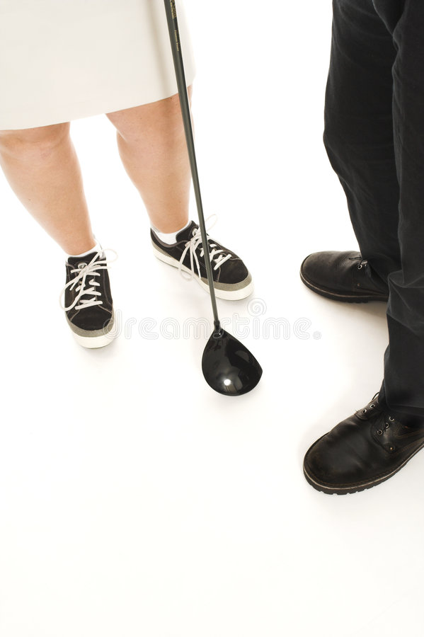 Couple with golf club royalty free stock image