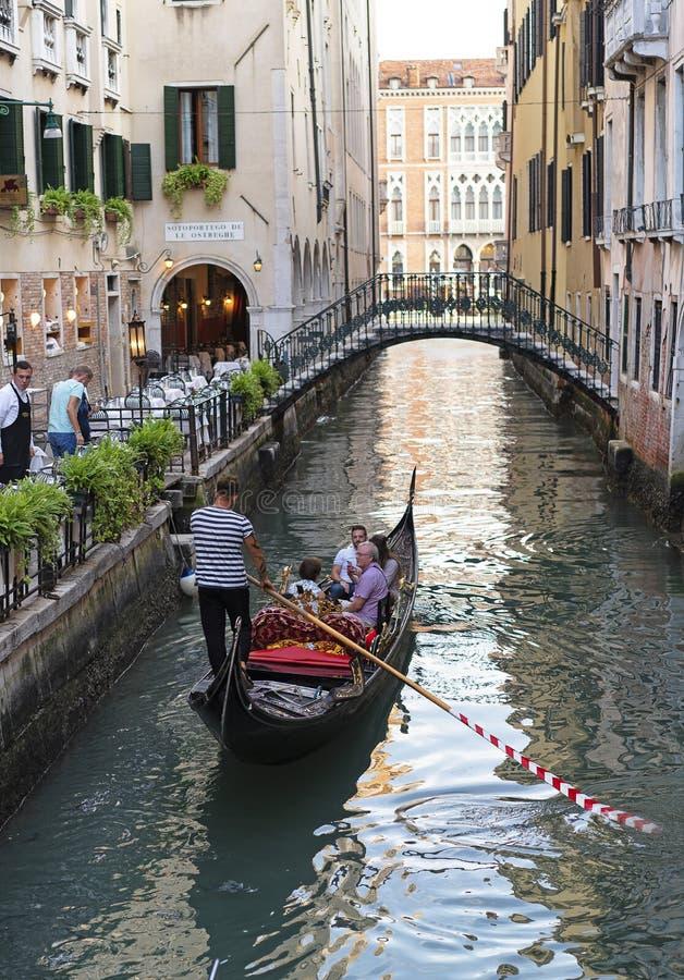 A couple in a gondola in Venice, Italy royalty free stock photos