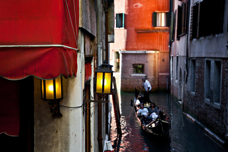 Couple in a gondola in Venice, Italy royalty free stock photography