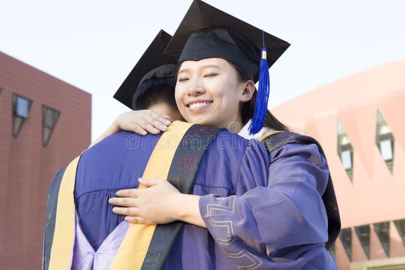 A couple of graduates stock photography