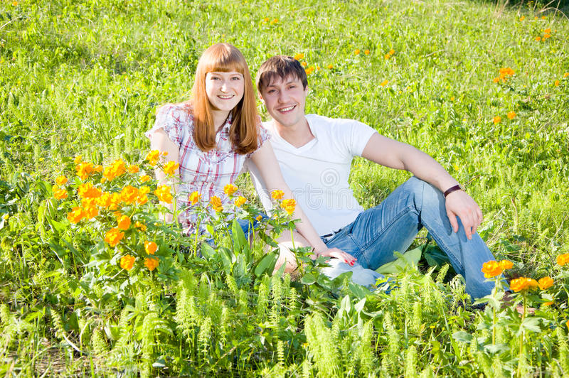 Couple on the grass stock image