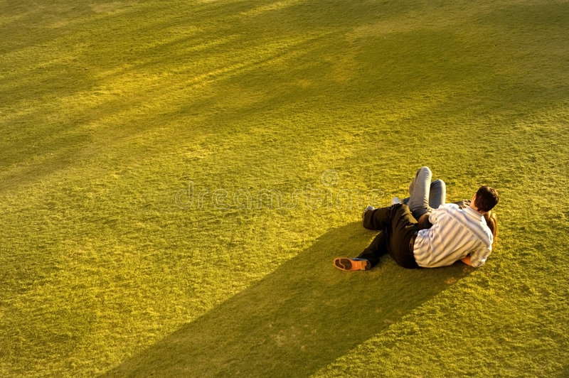 Couple on Grass stock images