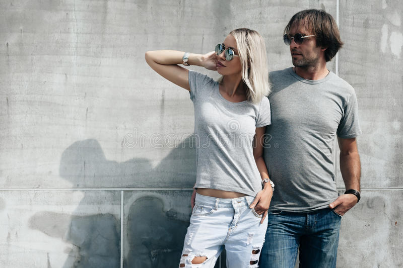 Couple in gray t-shirt over street wall stock images