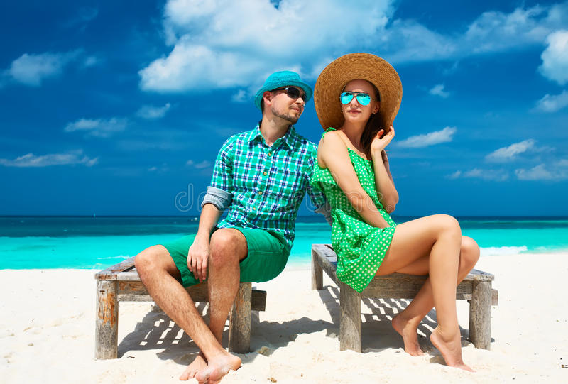 Couple in green on a beach at Maldives. Couple in green on a tropical beach at Maldives stock photo