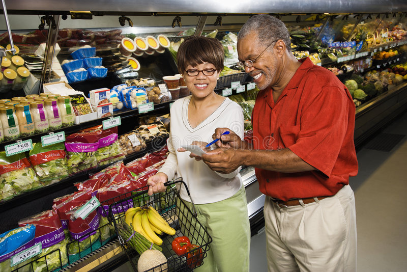 Couple in grocery store. royalty free stock photography