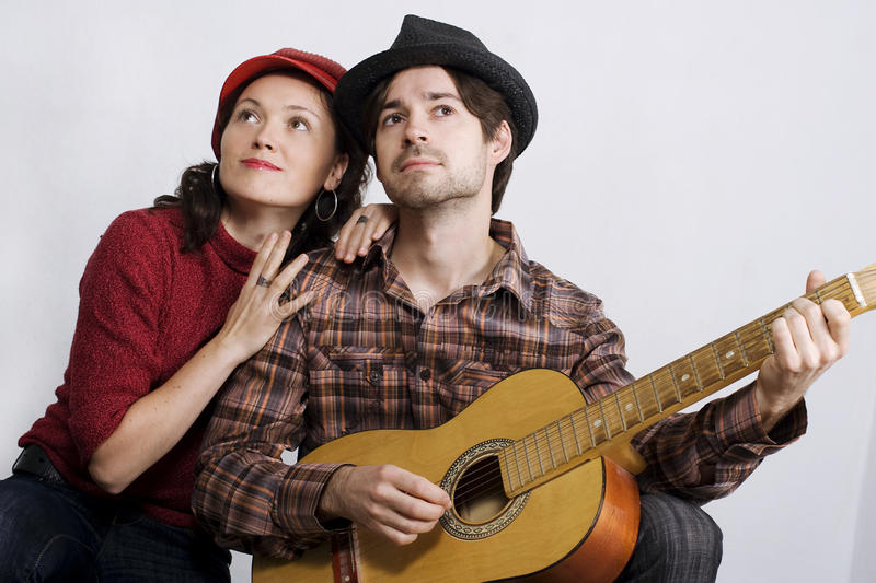 Couple with guitar royalty free stock photo