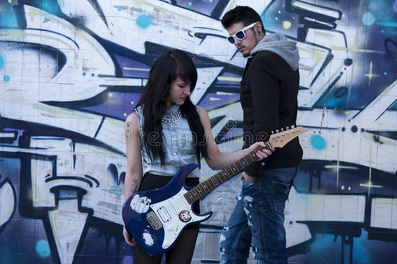 Couple with guitar. Couple with electric guitar, lifestyle royalty free stock images