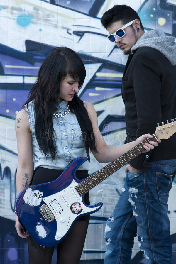 Couple with guitar. Couple with electric guitar, lifestyle royalty free stock image