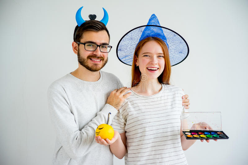 Couple in halloween costumes stock images