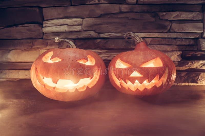 Couple of Halloween pumpkins stock image