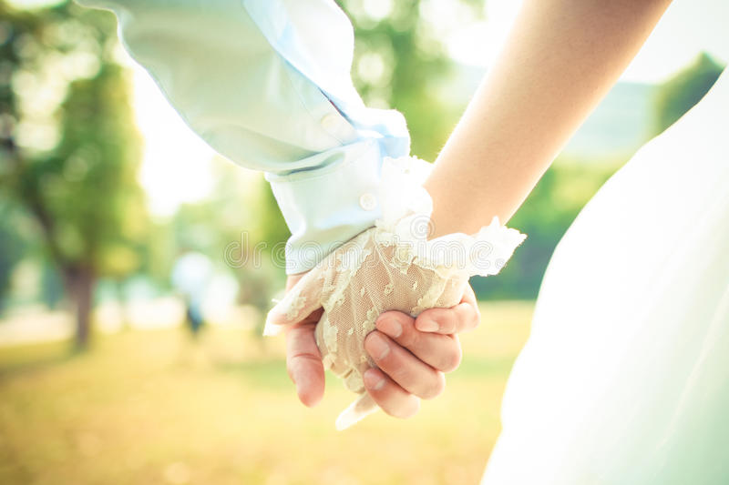 Couple hand in wedding stock images