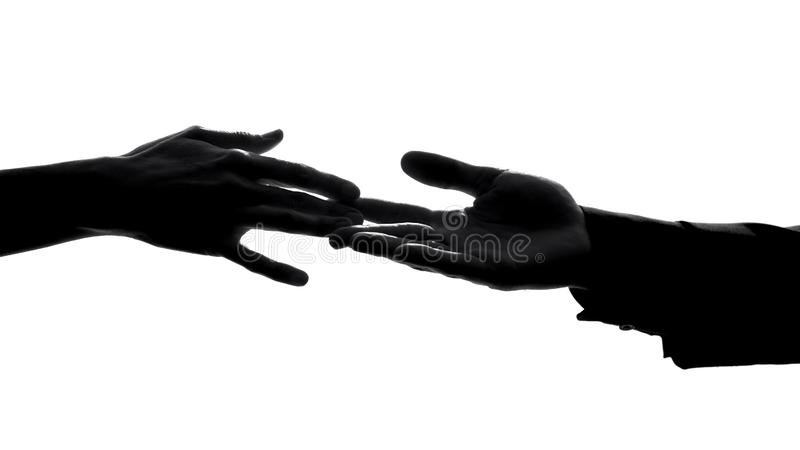 Couple hands separating, relations conflict, losing love partner, breakup symbol. Stock photo royalty free stock photography