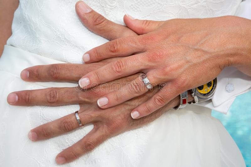 Couple hands wedding ring at marriage day stock photo