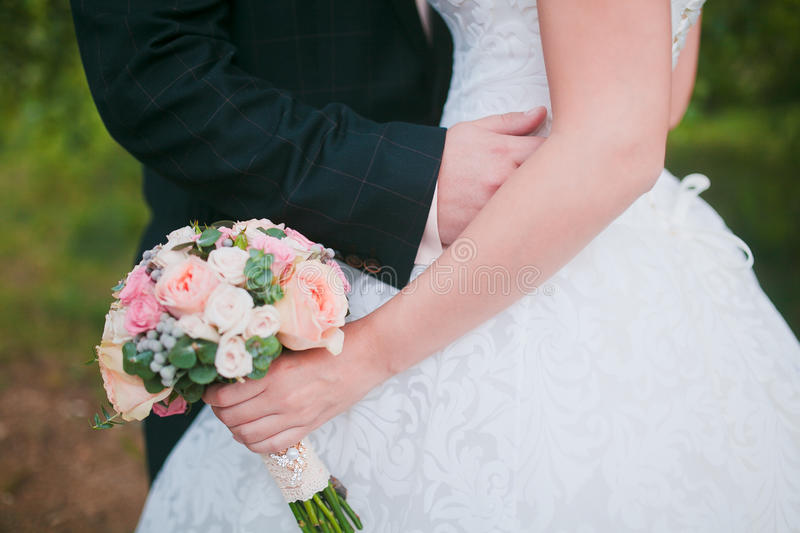 Couple hands on wedding stock photos