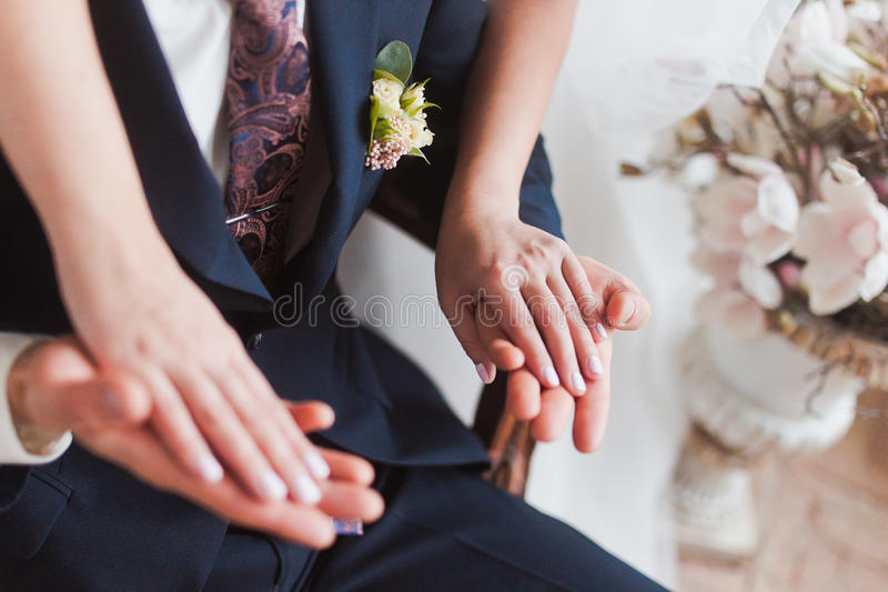 Couple hands on wedding royalty free stock photos