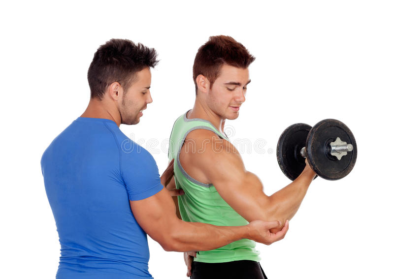 Couple of handsome muscled men training. Isolated on a white background stock photo