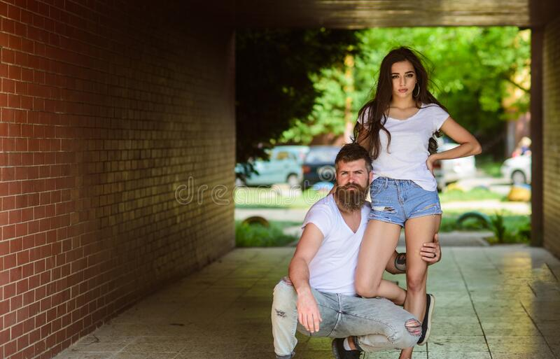 Couple hang out in porch or underground crossing. Couple in love cuddling in porch. Underground date. Girl attractive stock photography